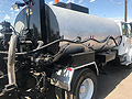 1999 Freightliner FL-80 with 2,000 Gallon Rosco Distributor